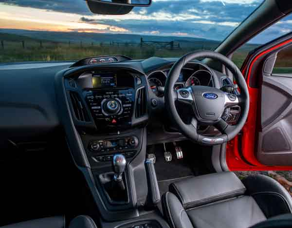 Inside there is a specially-designed steering wheel, gearshift and pedals