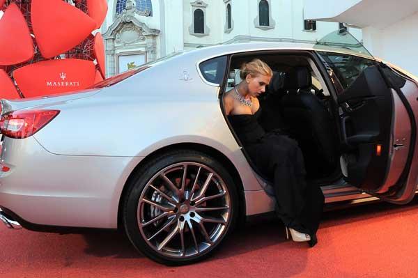 Scarlett Johansson arrives on the red carpet at the Venice Film Festival in a Maserati Quattroporte