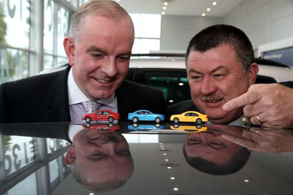 Tom Dennigan of Continental Tyres Ireland with Gerry Murphy, Chairman of the Irish Motoring Writers Association at the announcement of the field of runners for the 2014 Continental Irish Car of the Years awards