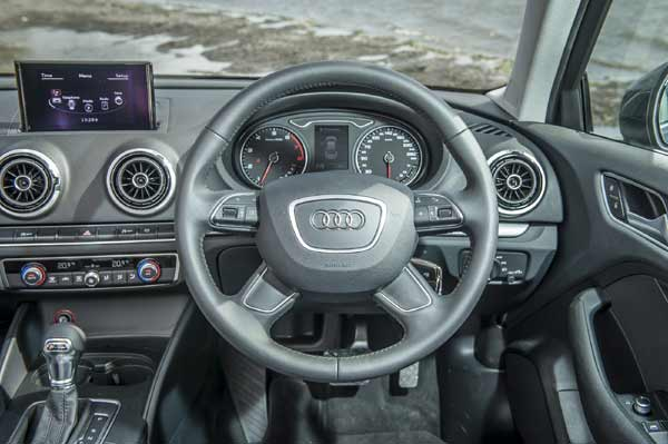 the interior of the audi a3 saloon is characterised by clean lines and impressive attention to